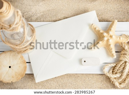 Few marine items on a wooden planks over sandy background. - stock photo