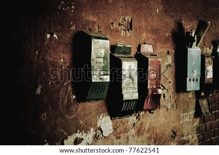 Few old mailboxes hanging on the wall - stock photo