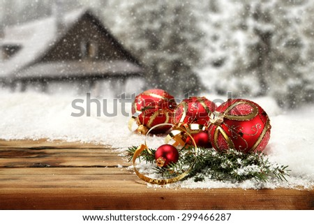 few red balls and green tree on snow  - stock photo