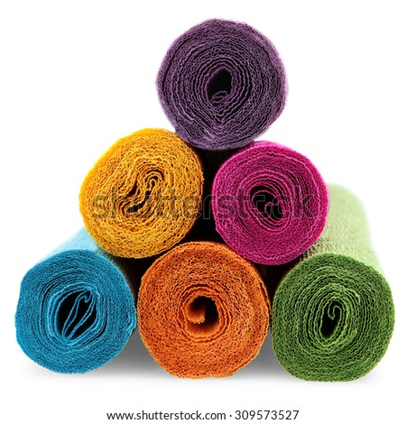 few rolls of crepe paper in different colors - stock photo