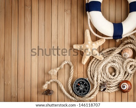 Few summer marine items on a wooden background. - stock photo