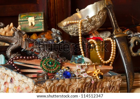 Few vintage treasure trunks with old jewellery - stock photo