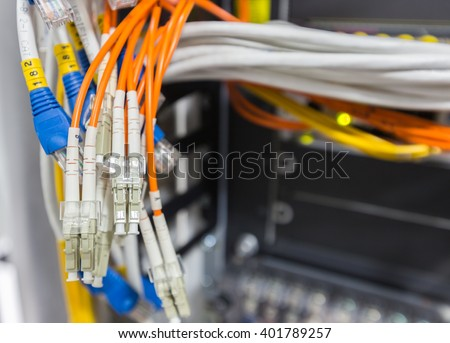 Fiber optic cable connect to network switch in data center  - stock photo
