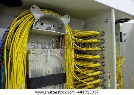 fiber optic Network Server . network cables and servers in a technology data center . selective focus - stock photo