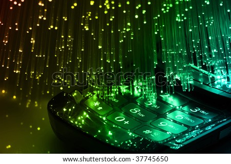Fiber optics background with lots of blue light spots - stock photo