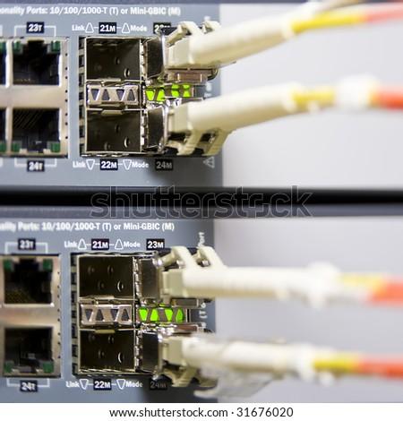 Fiber optics connectors on an internet server - stock photo