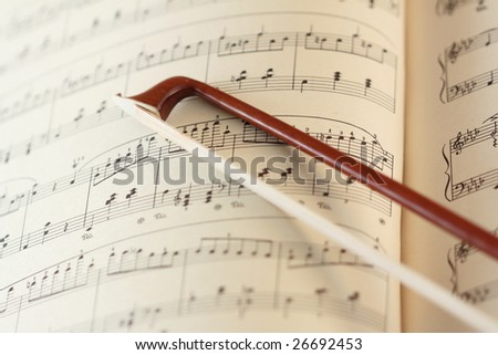 fiddle-stick on the music sheet - stock photo