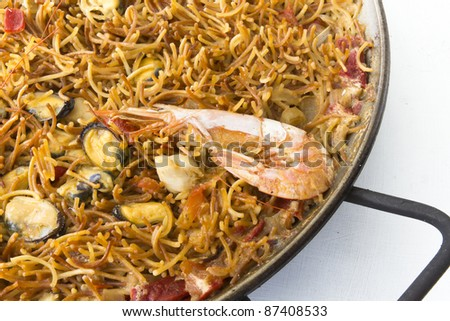 Fideua noodles made with roasted seafood, typical Mediterranean dishes - stock photo