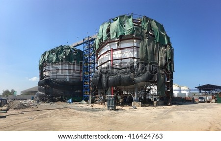 Field construction of LPG gas industrial storage sphere tanks - stock photo