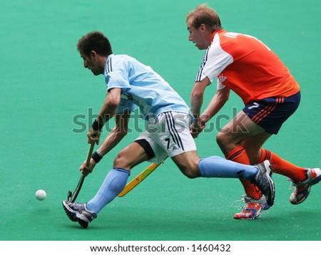 Field hockey match Agentina vs Netherland (orange) - stock photo