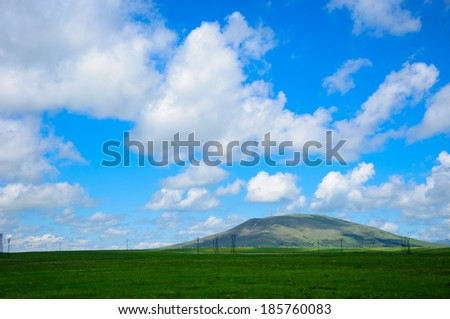 Field landscape with dramatic clouds  - stock photo