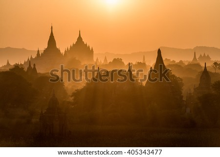 Field of ancient pagoda hiding in the mist Bagan Myanmar during sunset - stock photo