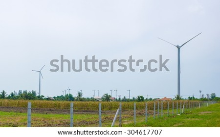 Field of white wind turbines generating electricity - stock photo