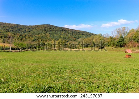 Field with a well - stock photo