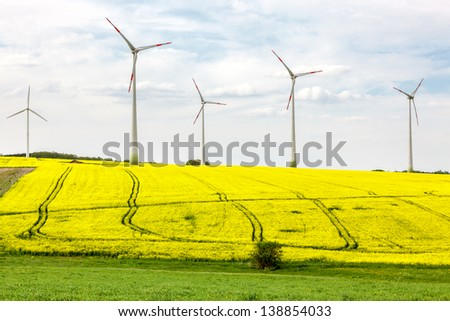 Fields and meadows with wind turbines - stock photo