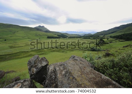 fields in the foothills of the drakensberg. view of the Umzimkulu valley, Drakensberg gardens, kwazulu Natal, South Africa - stock photo