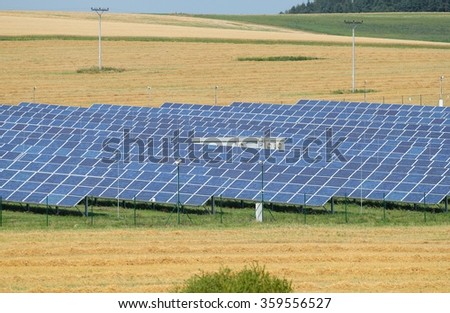Fields with lots of solar panels - stock photo