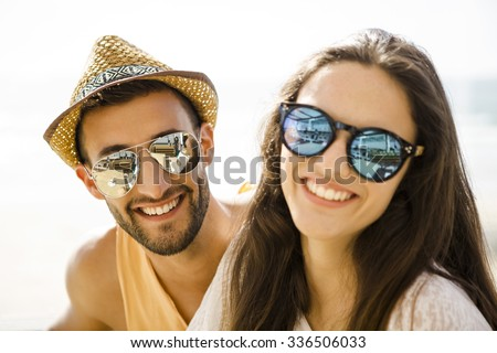 Fiends having a great time together at the beach bar - stock photo