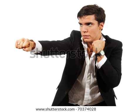 Fierce competition - business man fighting with fists wearing suit, isolated on white - stock photo