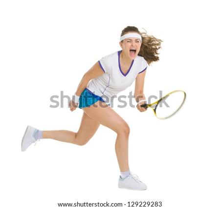 Fierce tennis player hitting ball - stock photo