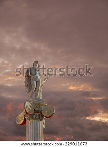 fiery cloudy sky over Apollo statue, the god of poetry and music - stock photo
