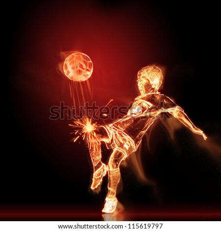 Fiery footballer with burning ball - stock photo