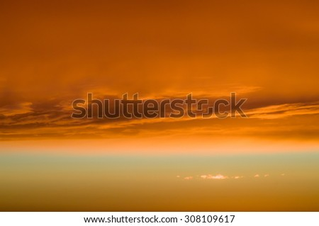 Fiery orange clouds and dramatic golden sky, sunset background - stock photo