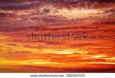 Fiery orange sunset sky. Beautiful apocalyptic sunset sky. - stock photo