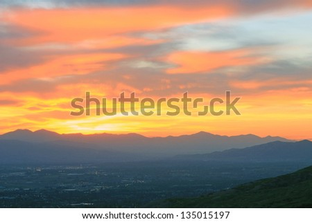 Fiery sunset above Utah Valley small towns, USA. - stock photo