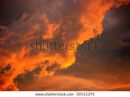 fiery sunset clouds over florida in brilliant colors - stock photo