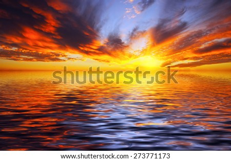 Fiery sunset over the sea in the tropics - stock photo