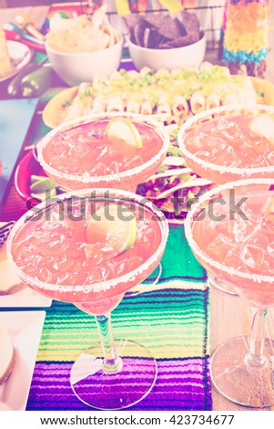 Fiesta party buffet table with dulce de lecheand other traditional Mexican food.traditional Mexican food. - stock photo
