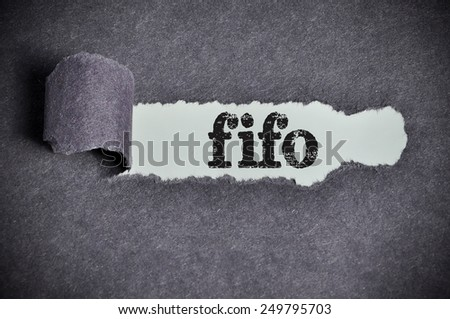 fifo word under torn black sugar paper  - stock photo