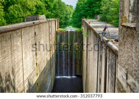 Fifteen meters waterfall on an abandoned river lock, Mazursky canal, former West Prussia - stock photo