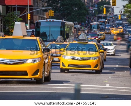 Fifth avenue yellow cab taxi 5 th Av New York Manhattan USA - stock photo