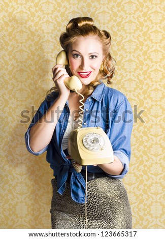 Fifties Classic Portrait Of A Vintage Woman Talking On The Old Fashioned Yellow Phone - stock photo