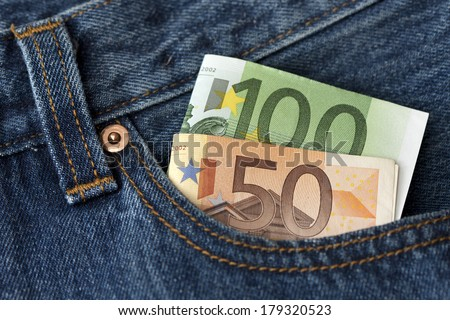 fifty and one hundred Euro banknotes in the pocket - stock photo