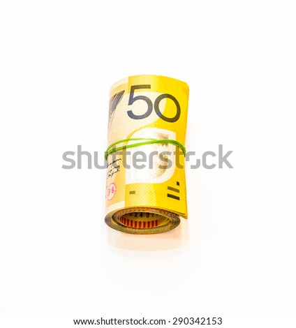 Fifty dollars Australian notes roll on white background - stock photo