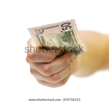 Fifty dollars in the hands of a man isolated on white background  - stock photo