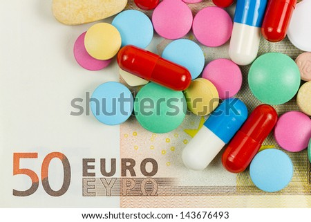 Fifty euro banknote with pills on it - stock photo