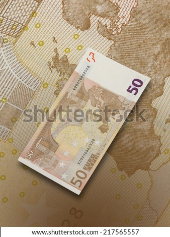 Fifty euro bills collage with warm tone. Vertical format - stock photo