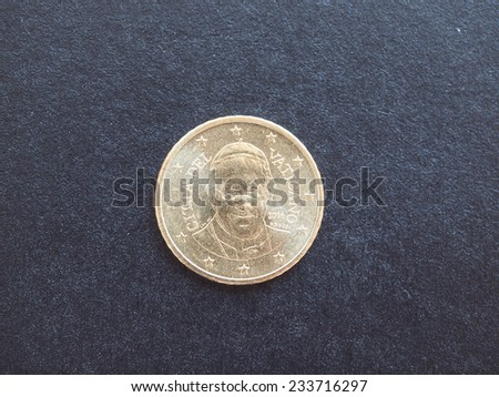 Fifty Euro cent coin from Vatican City bearing the portrait of Pope Bergoglio Francis I isolated over black background - stock photo