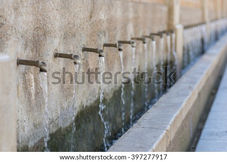 Fifty pipes fountain. - stock photo