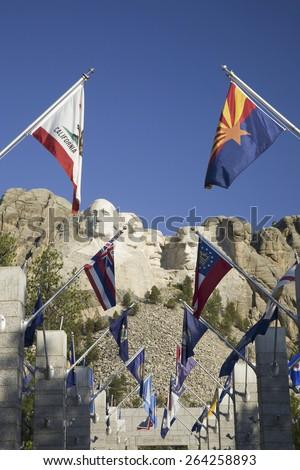 Fifty State flags lining the walkway to Grand Terrace view of Mount Rushmore National Memorial, South Dakota - stock photo