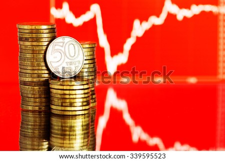 Fifty tenge - Kazakhstan money. Fluctuating graph on red background. Rate of the kazakh tenge(shallow DOF)  - stock photo