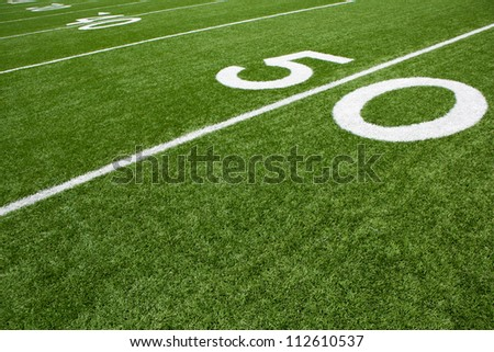 Fifty Yard Line of a Football Field - stock photo