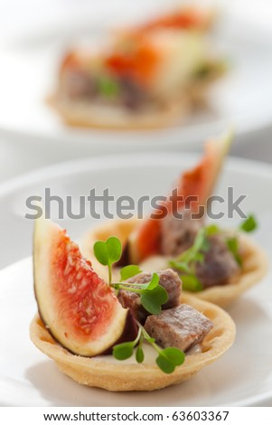Fig and pate tartlets for Christmas dinner - stock photo