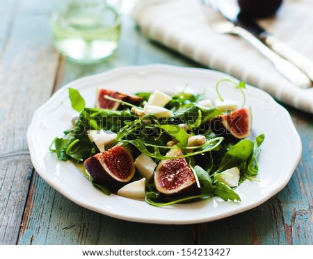 Fig,arugula and cheese salad - stock photo