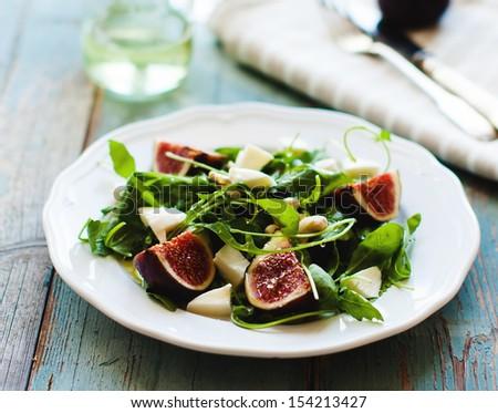 Fig,arugula and cheese salad - stock photo