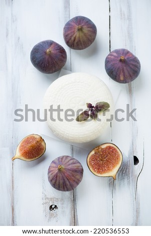 Fig fruits and cheese, above view, vertical shot - stock photo